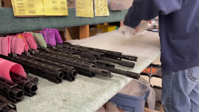 employee wrapping parts of ar-15 rifles in bubble wrap at davidson defense gun shop in orem, ut, u.s. on wednesday, march 10, 2021. sales and orders... - orem stock videos & royalty-free footage