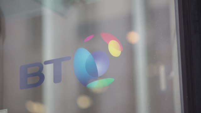 employees and guests pass through the entrance to the bt group plc headquarters in london, uk, on monday, dec. 15 pan up from the doors, pull focus... - plc stock videos & royalty-free footage