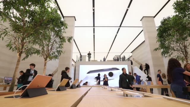 Employees and members of the media browse the newly refurbished Apple Inc store on Regent Street in London UK on Thursday Oct 13 2016