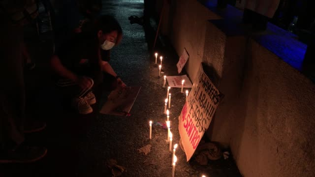 employees and supporters of abs-cbn gathered outside the media giant's headquarters to light candles and show support after the philippine house of... - franchising stock videos & royalty-free footage