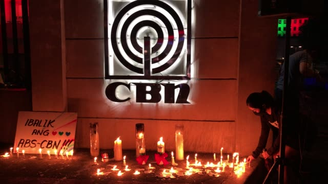 employees and supporters of abs-cbn gathered outside the media giant's headquarters to light candles and show support after the philippine house of... - philippines stock videos & royalty-free footage