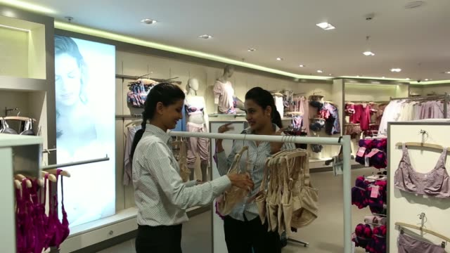 Employees arrange lingerie inside the new Marks Spencer Reliance India Pvt store in the Bandra area of Mumbai India on Sunday Nov 10 Employees walk...