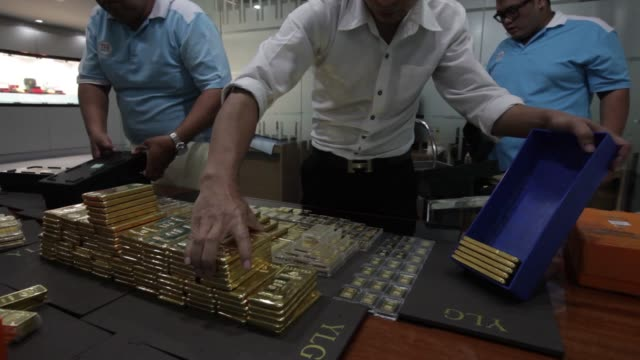 Employees arranges one kilogram gold bars at the YLG Bullion International Co headquarters in Bangkok Thailand on Wednesday Jan 13 Gold cars being...