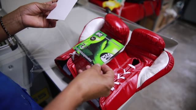 Employees assemble Cleto Reyes brand boxing gloves at their manufacturing facility in Mexico City Mexico on November 25th 2015 Photographer Susana...
