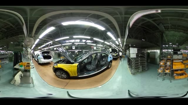 Employees assemble Hyundai Motor Co Genesis luxury sedans on the production line at the company's plant in Ulsan South Korea on Monday April 24 2017...