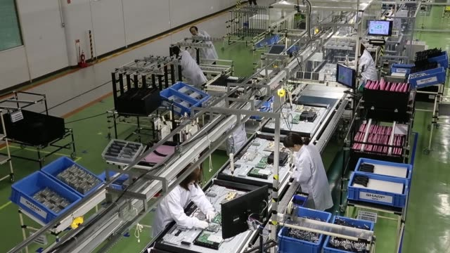 employees assemble sharp corp aquos liquid crystal display lcd televisions on the production line of the companys plant in yaita tochigi prefecture... - liquid crystal display television stock videos and b-roll footage