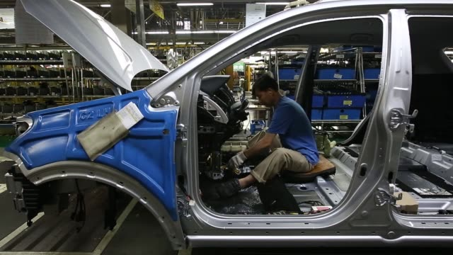 employees assemble ssangyong motor co korando c sport utility vehicles on the production line at the companys factory in pyeongtaek south korea on... - korea stock-videos und b-roll-filmmaterial