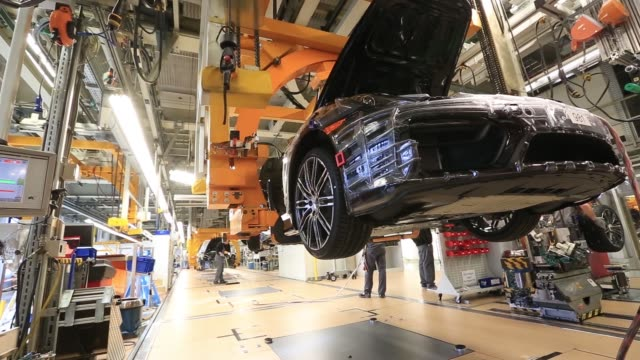 employees assemble the interior of a porsche boxster luxury convertible automobile on the assembly line at porsche ags factory operated by volkswagen... - nordeuropäischer abstammung stock-videos und b-roll-filmmaterial