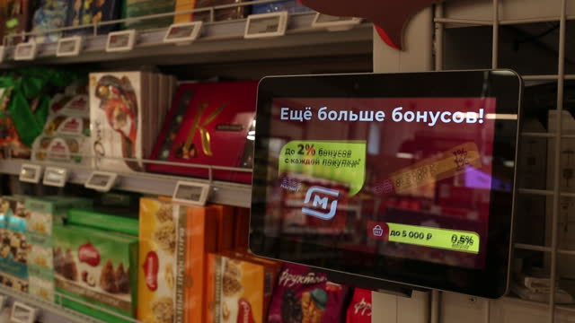 employees at a magnit pjsc distribution center in dmitrov and customers at a magnit pjsc supermarket in moscow, russia, may 21, 2021. magnit,... - catena di negozi video stock e b–roll