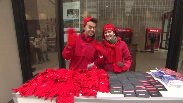 boa employees at jane krakowski and bank of america help new yorkers spread holiday cheer on december 12 2012 in new york new york - bank of america stock videos & royalty-free footage