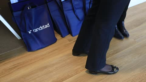 stockvideo's en b-roll-footage met employees attend a meeting, the randstad company logo in the background on december 4 in saint-denis, france. dutch multinational human resource... - rubriekadvertentie