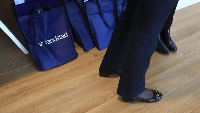 employees attend a meeting, the randstad company logo in the background on december 4 in saint-denis, france. dutch multinational human resource... - classified ad stock videos & royalty-free footage