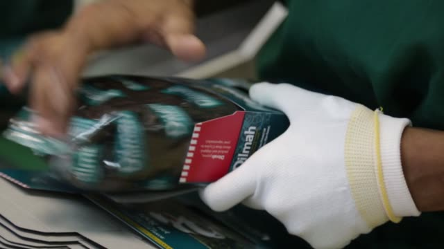 employees box tea bag packets on the packaging production line at the mjf holdings ltds dilmah tea headquarters and factory in the peliyagoda area of... - wrapping stock videos and b-roll footage