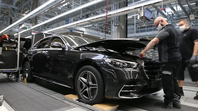employees carry out quality checks under the hood of a mercedes sclass luxury sedan on the final assembly line at the mercedesbenz ag factory 56 in... - bonnet stock videos & royalty-free footage