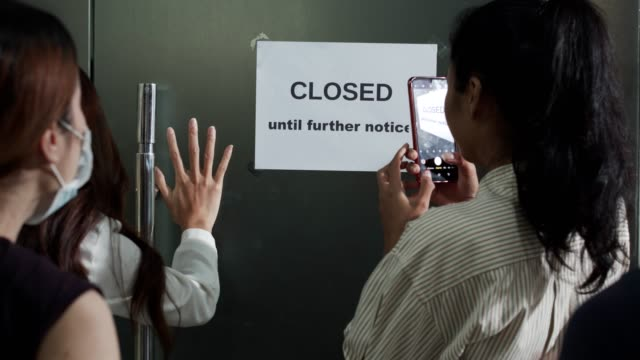"""employees come to office and see paper """" closed until further notice """" - information sign stock videos & royalty-free footage"""