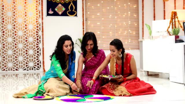 Employees decorating rangoli in the office, Delhi, India