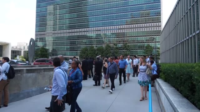 employees diplomats and visitors were evacuated tuesday morning from the united nations headquarters buildings in new york city following a fire... - fire alarm stock videos & royalty-free footage