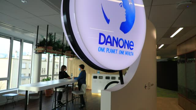 employees discuss in a meeting room next to a danone brand logo at the french agrifood giant new head office on january 26 in reuil malmaison,... - brainstorming stock videos & royalty-free footage