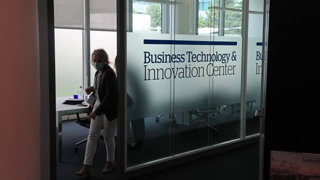 employees enter an office that reads business technology innovation centre before a press conference at atos technology days 2021 on july 2 in... - big data stock videos & royalty-free footage