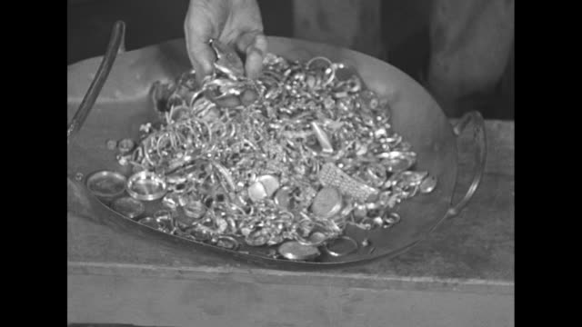 cu employee's hands taking lid off box full of gold jewelry he picks up handful of jewelry and places it in pan then he picks up box and pours... - jewelry box stock videos and b-roll footage