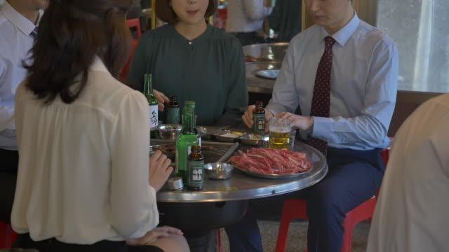 employees having a dinner at the company get-together - skjorta och slips bildbanksvideor och videomaterial från bakom kulisserna