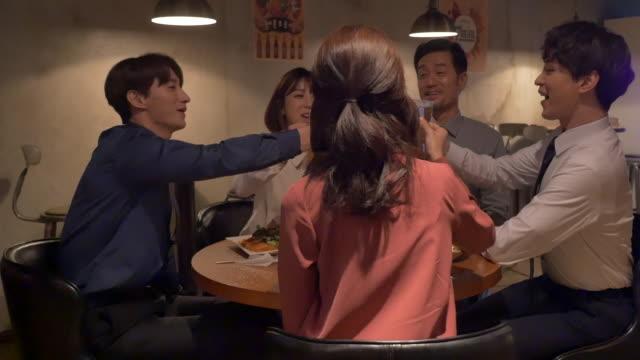stockvideo's en b-roll-footage met employees having a get-together at a bar - menselijke arm