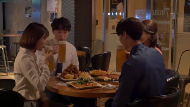 stockvideo's en b-roll-footage met employees having a get-together at a pub - menselijke arm