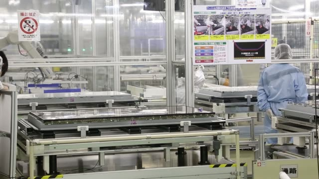 employees inspect sharp corp aquos liquid crystal display lcd televisions on the production line of the companys plant in yaita tochigi prefecture... - liquid crystal display stock videos and b-roll footage
