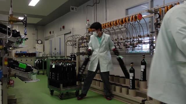 employees load medical gas cylinders on push carts at at chiyoda ltd. facility in asaka, japan on thursday, august 26, 2021. although covid deaths... - biochemistry stock videos & royalty-free footage
