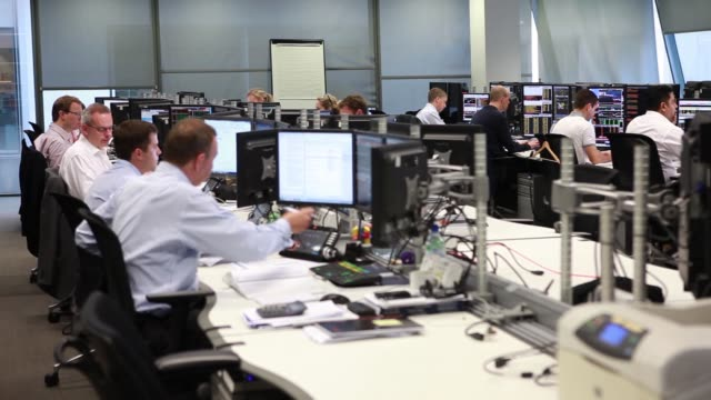 Employees monitor financial information on their computer screens on the morning that news from the Scottish independence referendum is announced...