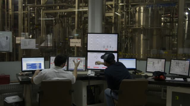 employees monitor the manufacturing process from the control room at ambev beer plant on july 17th lages, santa catarina's state, brazil. shots: wide... - plant process stock videos & royalty-free footage