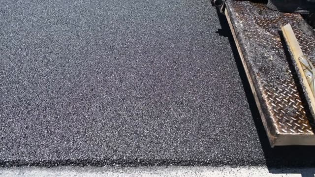 employees of advanced asphalt co pave a il state highway in streator illinois, us, on tuesday, june 2, 2015 shots: close up shot of a construction... - asphalt stock-videos und b-roll-filmmaterial