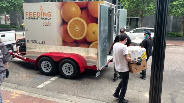 employees of bellwether restaurant carry boxes of prepared meals for distribution by feeding northeast florida on april 29 2020 in jacksonville... - meal box stock videos & royalty-free footage