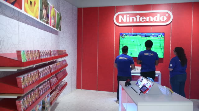 employees of new toys 'r' us store playing nintendo game, paramus, new jersey, u.s., on tuesday, nov 26, 2019. - toys r us stock videos & royalty-free footage
