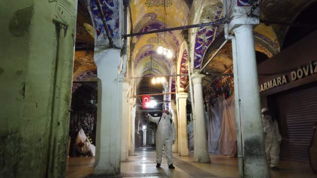 employees of the grand bazaar cleaning department disinfect the streets and shops inside istanbul's famous grand bazaar to prevent the spread of the... - イスタンブール グランドバザール点の映像素材/bロール