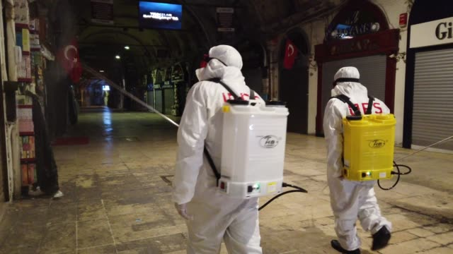 employees of the grand bazaar cleaning department disinfect the streets and shops inside istanbul's famous grand bazaar to prevent the spread of the... - grand bazaar istanbul stock videos & royalty-free footage
