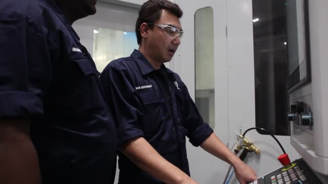 Employees operate a Pietro Carnaghi Spa machining center at the manufacturing facility of UMW Aerospace Sdn a unit of UMW Holdings Bhd in Serendah...