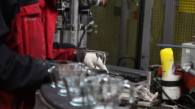 employees perform quality inspections on finished glass pieces inside the pyrex factory in charleroi pa tuesday february 2 2016 photographer victor... - blue glass stock videos and b-roll footage