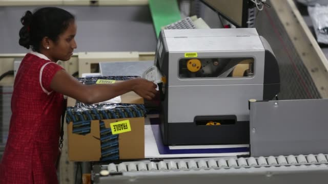 Employees prepare packages for shipment at the Amazoncom Inc fulfillment center in Hyderabad India on Thursday Sept 7 An employee prepares a package...