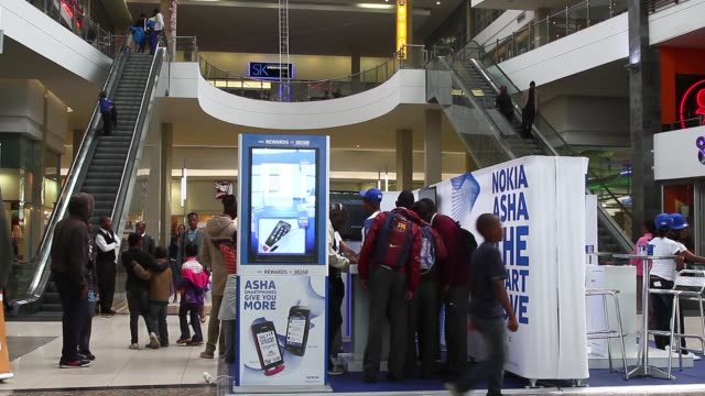 """employees promote new nokia asha smartphones to shoppers during a promotional """"activation day"""" event by nokia oyj in maponya mall in soweto, a... - pamphlet stock videos & royalty-free footage"""