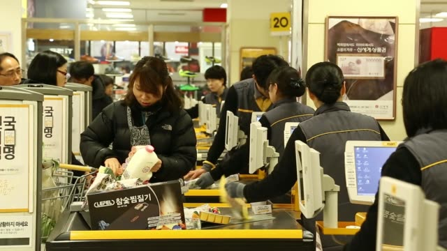 stockvideo's en b-roll-footage met employees serve customers at payment counters inside an emart co store a subsidiary of shinsegae co in incheon south korea on saturday dec 21... - incheon