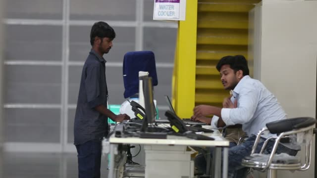 Employees stand at the warehouse floor of the Amazoncom Inc fulfillment center in Hyderabad India on Thursday Sept 7 Employees work on the warehouse...