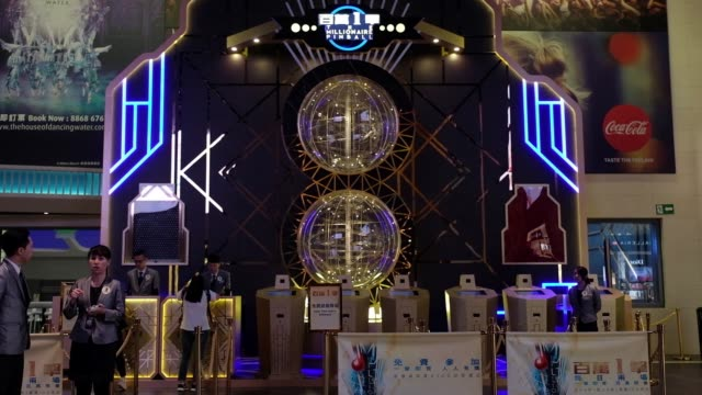 employees stand next to a millionaire pinball game at studio city casino resort developed by melco crown entertainment ltd in macau china on thursday... - studio city stock videos & royalty-free footage
