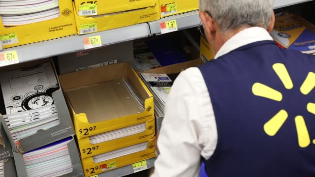 Employees stock the shelves to prepare for a back to school sale at a WalMart Stores Inc location in Burbank CA on November 22 2016 Photographer...