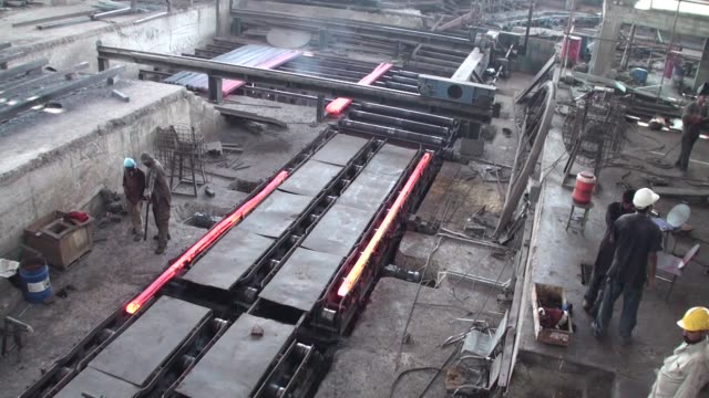 employees supervise red hot steel billets moving along a production line inside an agha steel industries ltd plant in karachi pakistan on saturday... - ladle stock videos & royalty-free footage