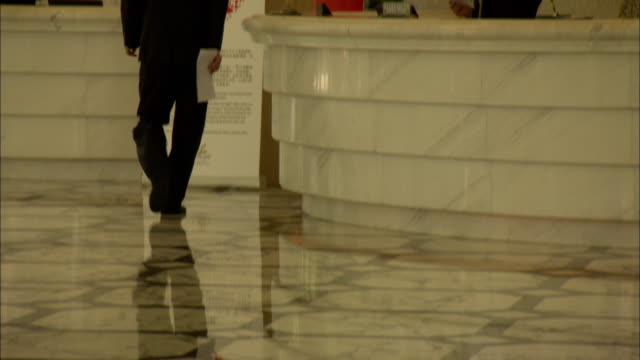 MS TU TD Employees walking on shiny marble floor at Skyway Landis Hotel, Shanghai, China