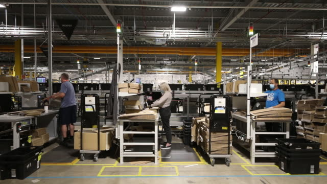 employees work at the amazon warehouse in kegworth, uk ahead of amazon prime day event on monday, october 12, 2020. - cardboard box stock videos & royalty-free footage