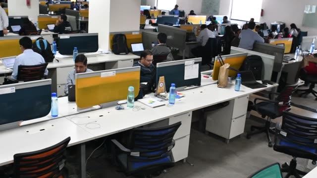 Employees work at the office of PayTM a unit of One97 Communications Ltd in Noida Uttar Pradesh India on Wednesday Dec 14 Vijay Shekhar Sharma...