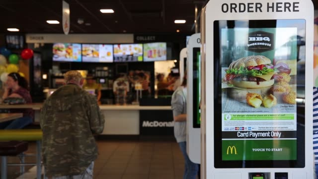 employees work behind the service counter inside a mcdonald's corp restaurant in manchester uk on monday aug 10 2015 shots customers use touch screen... - touch sensitive stock videos & royalty-free footage