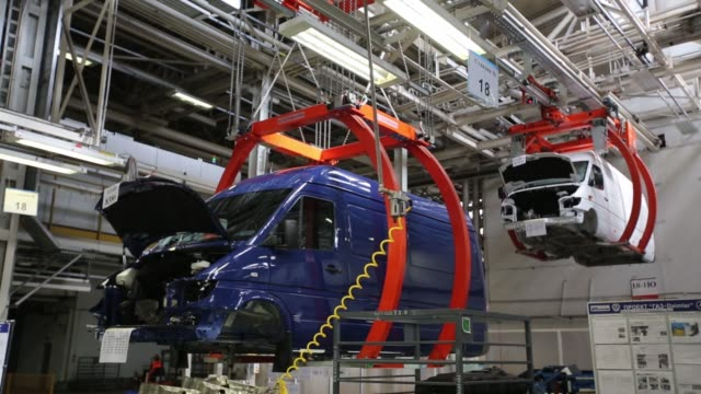 Employees work on a GAZelle Next vehicle during assembly on the production line at the Gaz auto plant operated by Gaz Group in Nizhny Novgorod Russia...